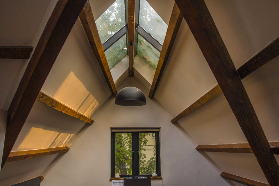 A cosy loft conversion with a windowed roof. A perfect example of a dream loft conversion and renovation project.
