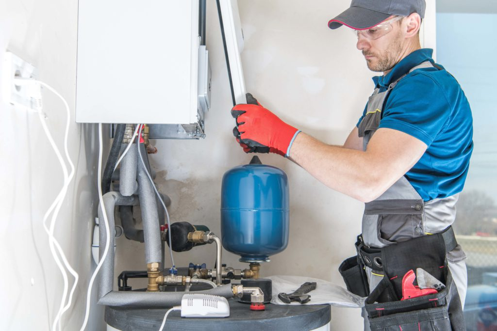 Plumber working on a boiler