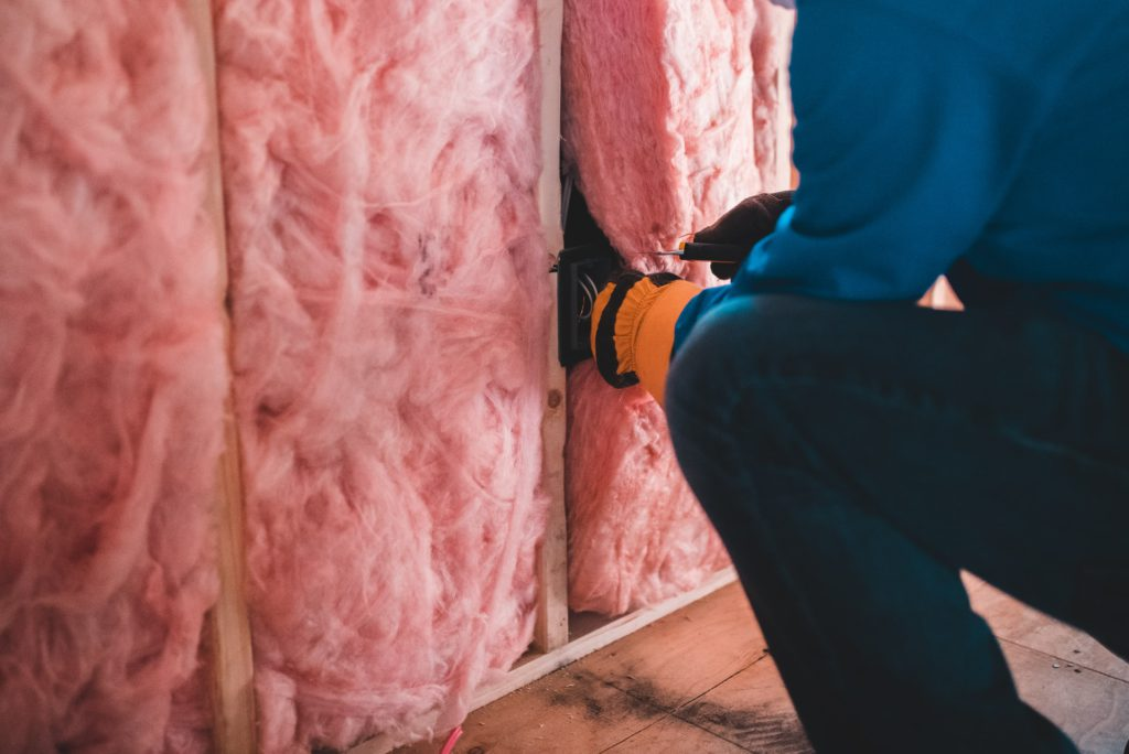 Insulation being installed into walls