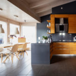 Modern kitchen with wood pannels and a white table and chair set