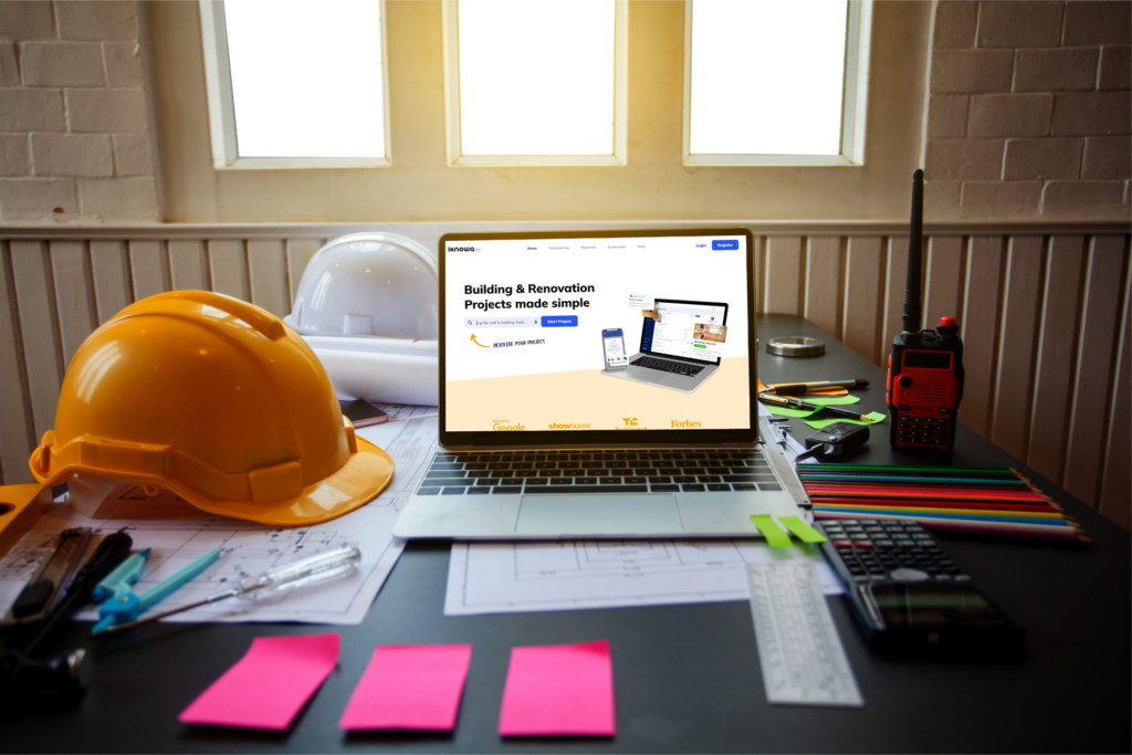 laptop on a desk surrounded by builders supplies with the iknowa website launched